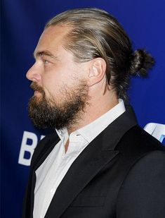 Leonardo DiCaprio Dressed long beard and ponytail . A look that change! Leonardo DiCaprio Dressed Spotted this weekend on the occasion of a new charity ev Man Bun Haircut, Man Bun Hairstyles, Hairstyle Look, Celebrity Hairstyles, Leonardo Dicaprio Beard, Leonardo Dicaprio Hairstyle, Man Ponytail, Hair And Beard Styles, Long Hair Styles