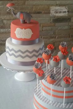 Baby shower cake and cake pops in coral and grey #babyshower #cakepops #babyshowercake with blue instead
