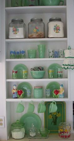 vintage jadeite display (I want a set of jadeite mugs so bad!)