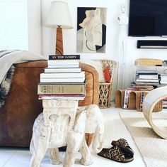 worn-leather-couch-elephant-side-table