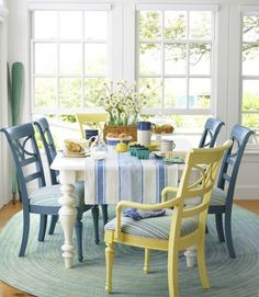 Mixing chair colors in blue & yellow makes this sitting space eclectic and fun!
