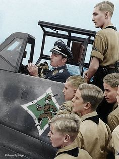 Herman Graf 202 victory ace sits in his bf-109G6 showing the JG50 insignia surrounded by young want to be pilots 1943. Pin by Paolo Marzioli