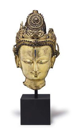 A gilt bronze head of a bodhisattva. NEPAL, 14TH CENTURY