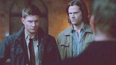 Dean's first instinct is to step between Sam and danger.  Sam moves in too. He's bigger than Dean in every way; taller, bulkier, but he still hides behind his big brother because its just natural instinct. Dean's priority is always to protect Sam, to the point where he puts himself in danger. Stepping behind him could be Sam's way of protecting Dean. If Dean knows Sam is safely behind him then he'll put more concentration into protecting himself, and if Dean is in danger Sam can still push…