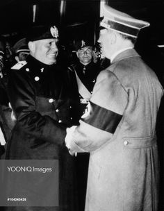Yooniq images - Adolf Hitler and Benito Mussolini Greeting Each Other and Shaking Hands, 1938