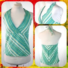 Teal Pinstripe V-neck Halter Top Size L or 10/12 Pretty halter top with white and teal pinstripe pattern. Teal lace along the neckline. Ties at the neck. Hidden zip closure in the back. Cotton/spandex. Size L or 10/12. In Excellent Condition! Magazine Tops Blouses