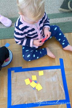 Paper or poms on contact paper - 21 Activities for One Year Olds - Baby Play - Wildflower Ramblings