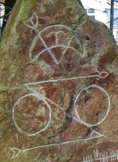 Pictish runes: V-rod and crescent and disced z-rod.   Reconstruction of an ancient stone at Mile-End at Beechwood.  Aberdeen.  Complete with Ogham.