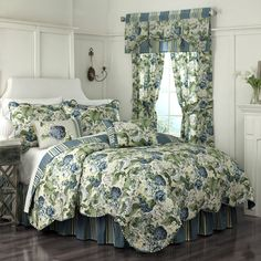 Floral Flourish by Waverly Bedding is a rich and traditional floral design. An elegant floral scape adorns the front of the quilt in shades of blue, yellow and green on an ivory background. The reverse is a coordinating stripe for a lovely finish. The quilt and pillow shams are scalloped and are accented with a decorative trim for a unique style. The Floral Flourish bedding sets include the quilt, pillow sham (s), and coordinating bed skirt. Bedding sets are available in sizes from Twin to…
