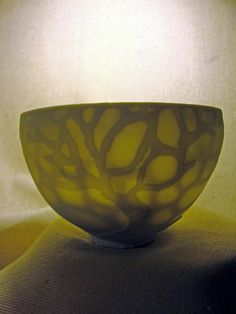 Large porcelain  bowl.... I love the light shining through the pattern.
