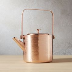 Shop copper teapot.   Hand-hammered by craftsmen in India, each copper-plated stainless steel teapot varies slightly in tone and texture.  Unpretentious cylinder shape lays low to let the copper shine.  For steeping and serving.