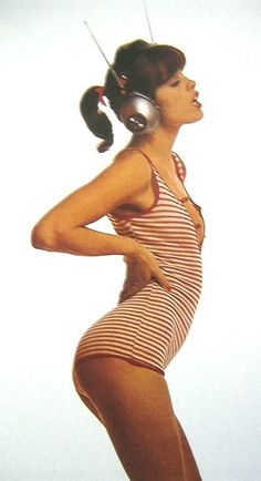 uschi obermaier in striped t and headphones. pretty sure she did barre work to get a bum like that. adorable.