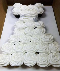 http://thewoodlandsresort.com/celebrations/weddings/  Wedding Dress Cupcake Cake Tutorial. Could also make it a princess dress with a round cake on top for the face. cute!