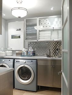 Clean and perfect laundry room.  Love the see-through cabinets... could easily do that in mine.  :) Stainless Steel Countertops, Sarah Richardson, South Shore Decorating, Stacked Washer Dryer, Diy Kitchen, Washing Machine, Home Remodeling, Laundry Room, Building A House