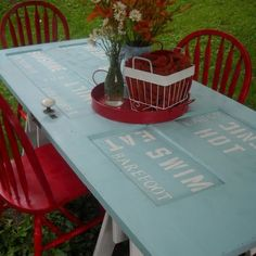 Great idea to paint words on it. Old Door Table