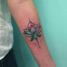 geometric watercolor lotus flower tattoo