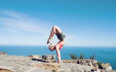 Handstand Scorpion (Vrschikasana) on top of Lions head in Cape Town | by JuYogi