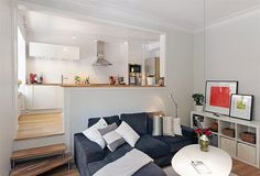 Kitchen next to sofa, different levels, The Most Stunning Small Apartment Design Ideas