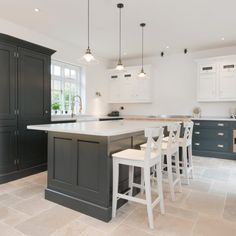A luxury handmade traditional style kitchen that oozes style and class. It features the Noble Carrara style quartz which complements the decor perfectly, with a very large island sitting in the middle and gorgeous brass features around the kitchen.