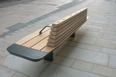 The benches and seats (with back and arm rests) incorporated a specially designed shallow mount anchor system to minimise the disturbance to street services and also allowed for removal of the seat, if necessary, without the destructive removal of paving. Street Furniture, City Furniture, Wood Furniture, Outdoor Furniture, Outdoor Decor, Anchor Systems, Curved Bench, Bench Designs, Public Seating