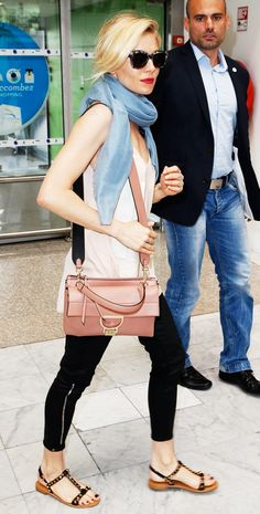Sienna Miller wears a light pink Coccinelle bag