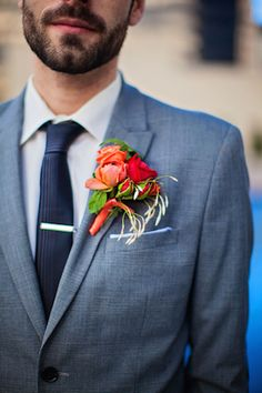 Red and orange boutonniere | Urban Safari Photography | see more on: http://burnettsboards.com/2014/09/four-seasons-denver-wedding/