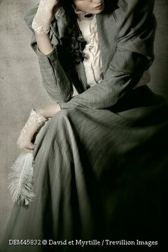Trevillion Images - historical-woman-in-suit-with-feather
