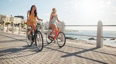[ Two Young Female Friends Riding Their Bicycles On The Seaside Promenade. Cheerful Young Women Riding Bikes At The Waterfront On A Summer Day. Best Essential Oils, Essential Oil Uses, Young Living Essential Oils, Summer Is Coming, Young Female, Female Friends, Menorca, Photo Canvas, Unique Photo