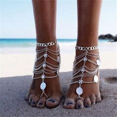 Barefoot sandals are the perfect accessory for beach events. Enjoy the lovely feeling of the sand on your toes while styling your feet with this lightweight fashion jewelry. The intricate design is re
