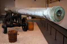 Queen Elizabeth's Pocket Pistol, the Long Gun of Dover Castle, Kent, England, UK. 24-foot basilisk (bronze cannon) built 1544 by Jan Tolhuys (Utrecht, Netherlands). 4.75 inch calibre. Presented to Henry VIII by Maximilian of Egmont. 1827 carriage made from French guns captured Waterloo 1815. Once called Queen Anne's Pocket Pistol. Housed in Regimental Institute (now Naafi Restaurant). Listed Building, English Heritage site. Artillery and History. See: http://www.panoramio.com/photo/54982085