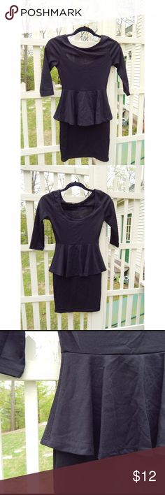 Black peplum body con dress Super cute black body con dress with a peplum skirt! Only worn twice! The back scoops down a little lower. Charlotte Russe Dresses Mini