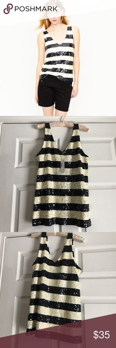 NWT J. Crew Retail Navy Stripe Sequin Tank Brand new, never worn with tags! No defects! Navy blue and ivory sequin stripes. V-neck. 100% cotton. All of my items come from a clean, smoke-free home! Check my closet for more items and save when you bundle! Please let me know if you have any questions! J. Crew Tops Tank Tops