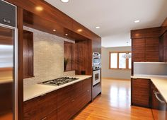 Mid-century modern kitchen by Shelter Architecture. Clean lines in kitchen. Backsplash ideas/colors.