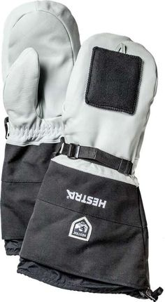 HESTRA Sirius Polar Mitt from Sweden. A heavy mitten developed for extreme conditions such as polar expeditions and mushing in cold climate. Comes with a harness with carabiners. Also features removable wipe pads for nose or goggles. Adjustable pull strap around the wrist. Made of durable goat leather and canvas fabric. Removable wool liner inside.