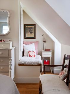 Storage Solutions for Small Bedrooms - Tackle the Corners via bhg.com - In a small bedroom, it's important to embrace every inch of square footage. Take a cue from this attic bedroom and tackle a corner oddity by incorporating a small built-in bench. The bench makes use of potentially wasted space below a window to create a cozy reading nook.