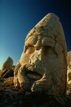 ✮ A close view of the head of the Greek god Heracles which toppled from its body during an earthquake at Nemrud Dagh, Turkey