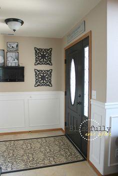 White wainscoting with oak trim. Dark door. LOVE