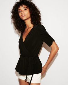 Fun and flattering style elements team up in this top that brings lightweight loveliness to day or night looks.