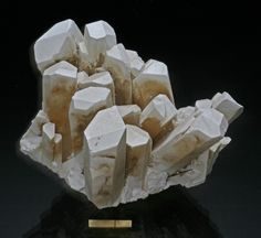 Borax, Na2B4O5(OH)4•8(H2O), and Tincalconite, U.S. Borax Mine, Kramer Borate deposit, Boron, Kramer District, Kern Co., California, USA. Dimensions: 12 x 10 x 10 cm. A cluster of prismatic borax crystals probably more than 60% altered to tincalconite. Uploaded by: Rock Currier