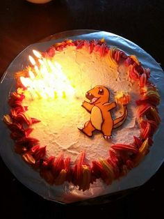 Charmander cake for my brother. Butter cream flames around the edges using a star nozzle, fondant Pokémon