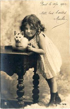 Child and cat.   Can you read the script?