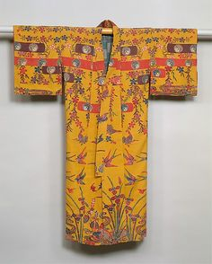 """Robe, 19th c., Japan, Okinawa, resist-dyed and painted silk crepe. """"This Okinawan costume features a pattern that largely incorporates motifs identified with Japan—irises, water plants, and embankment baskets at the hem, with cherry blossoms and birds in flight at the shoulders and waist."""""""
