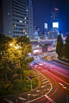 City night scene with car motion lights in Tokyo, Japan