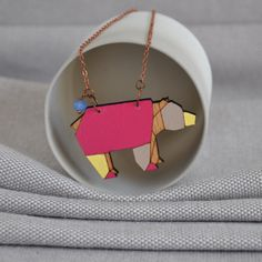 Origami Bear from ArtySmartyShop.com  This origami style necklace is made from birch wood, carefully hand painted in pastel colors and finished with a durable varnish. The chain is an vintage style antiqued copper with a lobster clasp, glass bead and 'artysmarty' rabbit tag.  #artysmarty #fashionbloggers  #accessories #womenswear #jewelrydesign