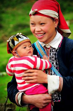 Northern Vietnam ~ a mother of the Red Dzao tribe.