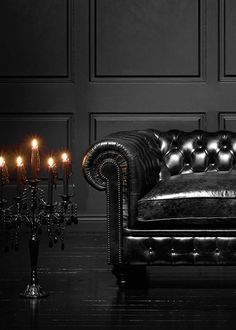 "mau-indy: "" sirloin: "" Black tufted leather chesterfield couch. "" """