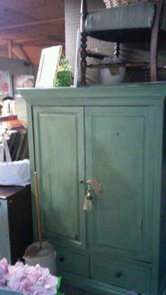 Green armoire satin finish antiqued. Great for TV,holding blankets or toys and games
