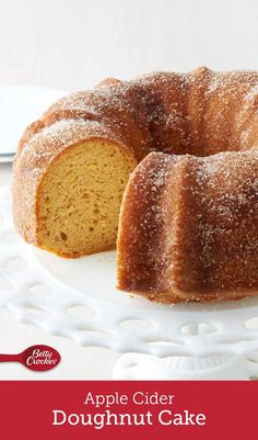 "Nothing says ""fall"" quite like an apple cider doughnut, and with this easy bundt, you get a crowd-friendly version of everyone's favorite seasonal treat. The yellow cake batter gets an apple infusion with cider and shredded apples before being baked and f Köstliche Desserts, Delicious Desserts, Dessert Recipes, Cupcakes, Cupcake Cakes, Apple Cider Donuts, Apple Cider Donut Cake Recipe, Doughnut Cake, Bunt Cakes"