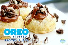 Oreo Stuffed Pastry Puffs - Like a fried Oreo, but without the grease! This is possibly my new favorite dessert. Soft oreo, flaky dough, and gooey melted chocolate. Perfection!