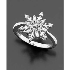 I stumbled upon this, good use of baguette diamonds. Makes it more snowflake and less flower like.
